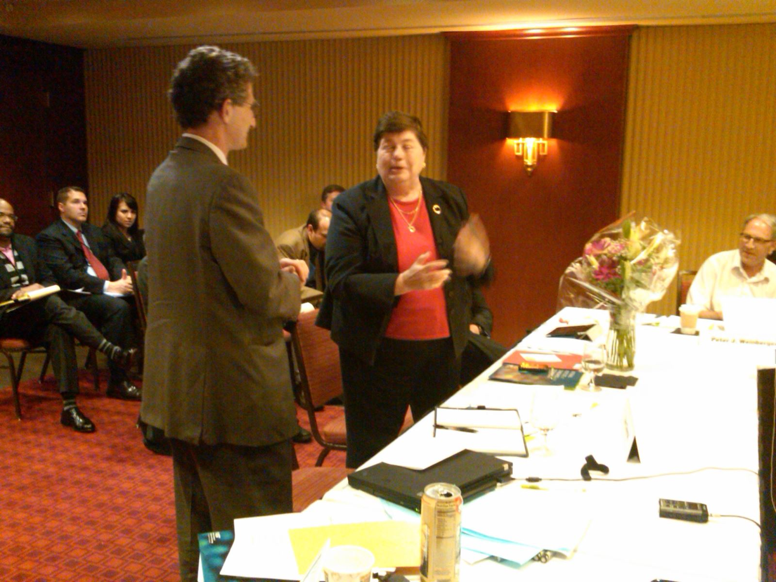 Dan Chenok (Chair, ISPAB) presents a bouquet to Cita Furlani (ITL Director, NIST) for her contribution and leadership.